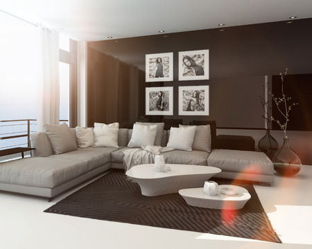 Hot sunny modern sitting room interior with sun flare through a large floor-to-ceiling window, art on the dark accent wall and a comfortable lounge suite