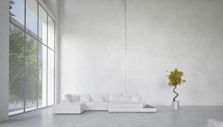 Dubbel volume ruime woonkamer interieur met grote panoramische ramen met uitzicht op een tuin en een hoekopstelling wit bankstel tegen een kale witte muur