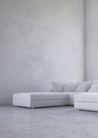 Minimalist living room interior with an upholstered corner suite against a double volume bare mottled grey wall in an architectural background photo