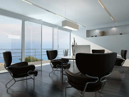 角の所で esasel と海を見渡せるガラスの壁の前に中央のテーブルの周りに散在のアームチェアが備わる現代的なオフィス会議室インテリア