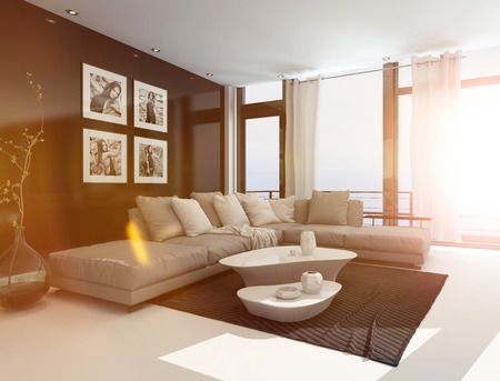 Comfortable living room interior with an upholstered corner lounge suite, coffee tables and artwork on the walls in bright sunlight with lens flare photo