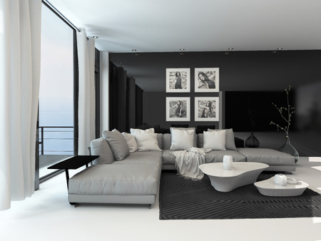 stark: Lounge interior with a dark accent wall and floor-to-ceiling window overlooking the ocean furnished with a comfortable beige lounge suite and modern tables