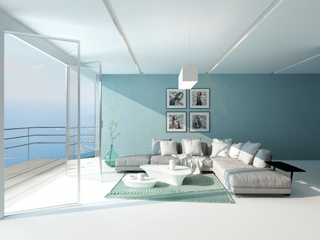 Bright airy sitting room with a panoramic floor-to-ceiling window overlooking the sea furnished with a comfortable suite and aquamarine accent wall photo