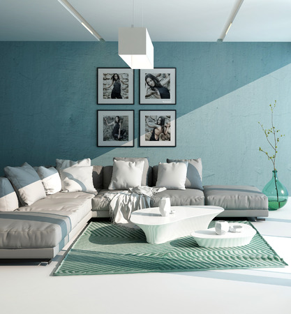 room accents: Confortevole interni salotto contemporaneo con una stretta di vista di una suite grigia imbottita con cuscini contro un muro acquamarina con opere d'arte