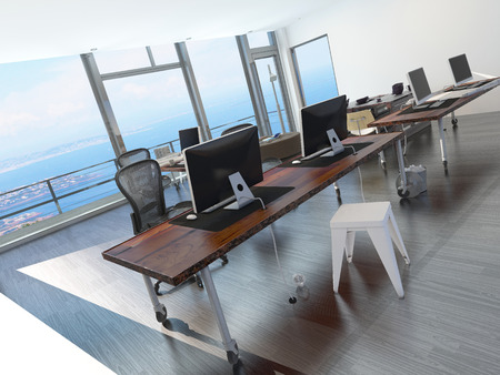 Modern minimalist coastal office overlooking the sea with a long office table with several computer workstations and a glass view wall photo