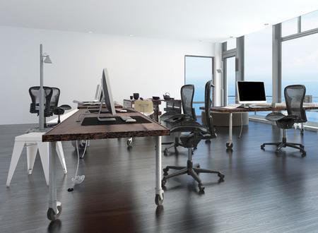 Intérieur de bureau minimaliste contemporain avec les postes de travail mis en place sur une table mobile et une fenêtre du sol au plafond de verre donnant sur l'océan