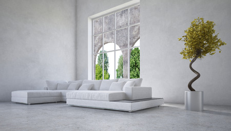 Stylish modern living room interior with an arched window overlooking a garden and modular corner suite in white with mottled light grey decor and an interesting twirled potted tree photo