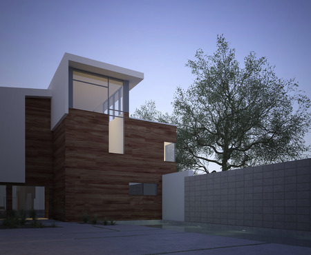 Modern contemporary house facade with an exterior courtyard and tree in evening light with vignetting 版權商用圖片