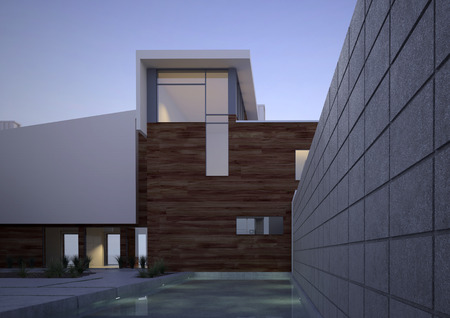 vignetting: Modern contemporary house facade with an exterior courtyard and swiming pool in evening light with vignetting Stock Photo
