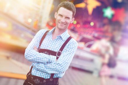 lederhosen: Handsome guy wearing Bavarian Lederhosen trousers with his arms folded