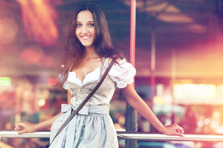 dirndl: Beautiful German Woman posing and wearing a traditional Dirndl