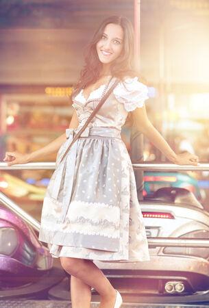 dirndl dress: Beautiful German Woman posing and wearing a traditional Dirndl