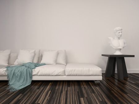 Interior decor in a classical living room with a white marble bust on a table alongside a comfortable upholstered white sofa with a blue throw rug against a white brick wall with parquet floor photo