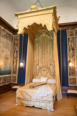 bedchamber: Baroque bed at state bedchamber at Hampton Court Palace near Londn Editorial