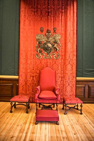 Red throne inside Hampton Court Palace near London, UK