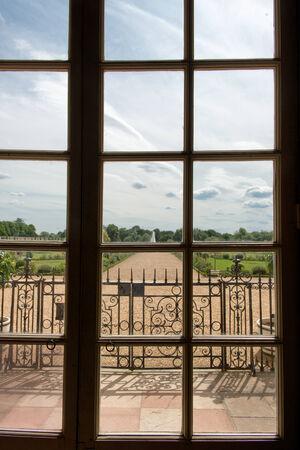privy: Framed window view toward the Hampton Court Palace gardens Editorial