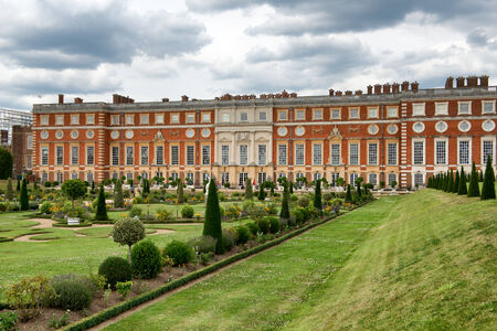 privy: Picturesque view of Hampton Court Palace, London, UK looking across the manicured lawns at the stately renaissance facade Editorial