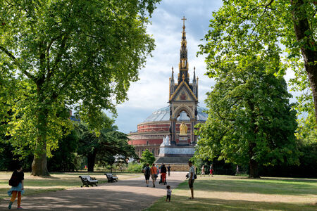 Unknown people near the Albert Memorial in Kensington Gardens, London, UK