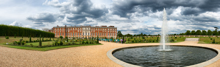 Hampton Court Palace and pond at Privy Gardens near London