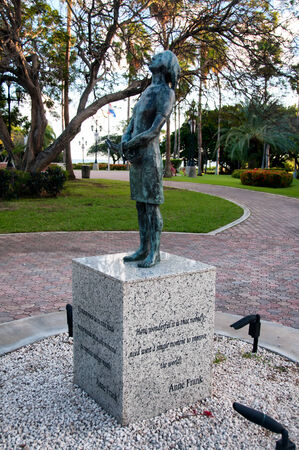 anne: Memeorial to the holocaust in Oranjestad, Aruba with a statue of a nazi soldier on a stone plinth