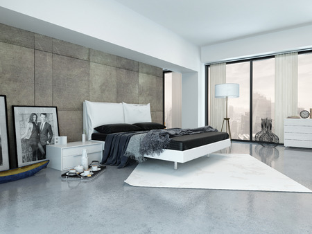 Modern bedroom interior with a double divan bed, paneled wall and large view windows with an urban view and a breakfast tray on the floor photo