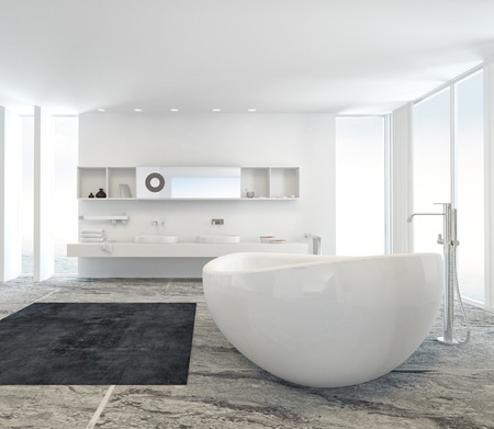 Modern bathroom interior with a freestanding white tub on a marble floor with double wall-mounted vanity unit behind between two floor to ceiling windows Foto de archivo