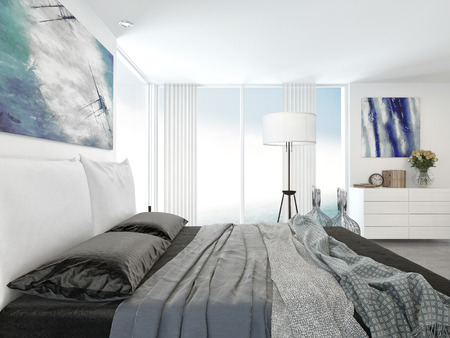 Grey and white bedroom interior with a view across a double bed to a corner view window with cabinets and a freestanding lamp with abstract art on the walls photo