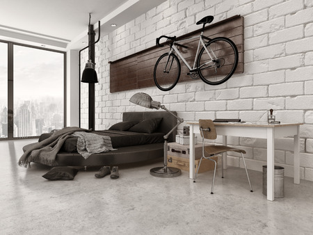 Modern Loft Style Bedroom in Apartment with Exposed Brick Wall, Desk, and Bicycle Hanging Up Stock Photo