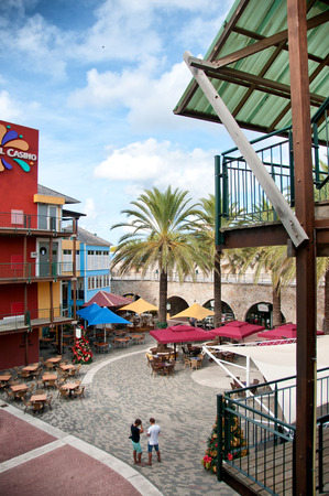 palm lined: Rif Fort outdoor restaurant and street market in Willemstad, Curacao, Dutch Antilles in an urban square lined with tropical palm trees on a sunny day
