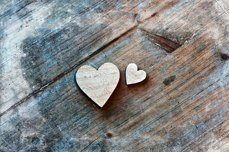 Two Wooden Hearts on Wooden Background as seen from Above