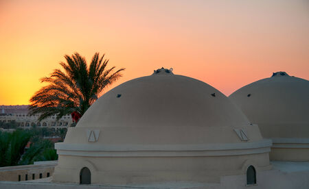 hurghada: White Domes and Palm Trees Over Hurghada City at Sunset