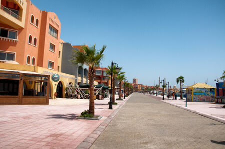 palm lined: Buildings Along Palm Tree Lined Promenade at Hurghada Waterfront, Egypt
