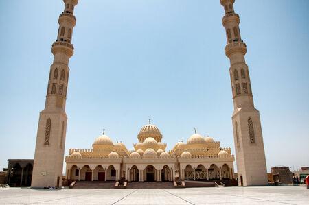 Facade of El Mina Masjid Mosque with Minarets on Sunny Day, Hurghada, Egypt photo