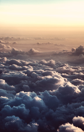 cloud cover: Overview of Clouds in Warm Light as if at Dusk or Dawn and Taken from Airplane
