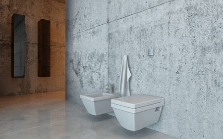 Modern wall-mounted toilet and bidet in an upscale restroom interior with a mottled grey and white marble wall photo