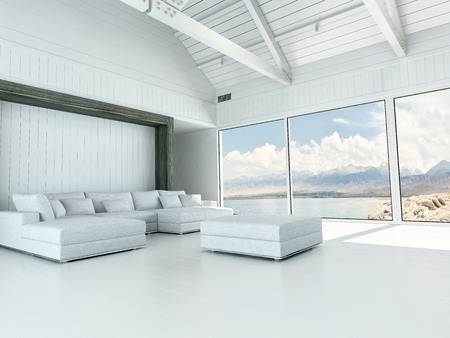 Modern white living room interior with large view windows overlooking the coastline and ocean and a corner unit lounge suite and ottoman with a white floor and open to the rafters white ceiling Archivio Fotografico