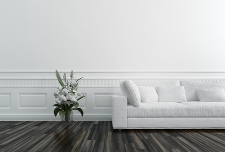 Flowers in Vase next to White Sofa in Luxury Upscale Home Foto de archivo