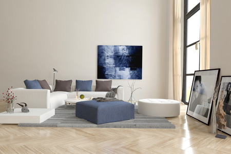 Living room interior with a herringbone parquet floor and comfortable modern modular upholstered lounge suite with artwork on the walls
