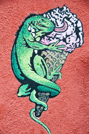 avid: Illustration of Lizard Licking Ice Cream on Red Stucco Wall Editorial