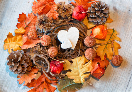Two Wooden Hearts in Autumn Foliage Nest as seen from Above photo