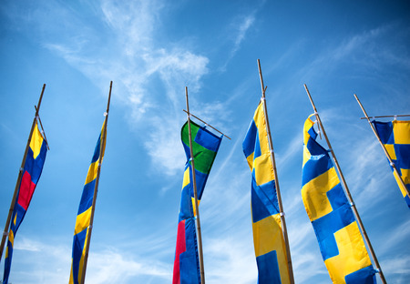 Colorful flags against blue sky in Ulm Germany during the annual International Danube Festival photo
