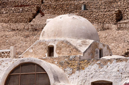 hemispherical: Architectural Detail of White Dome on Stone Building