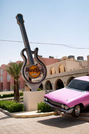 hard rock cafe: Exterior of Hard Rock Cafe in Hurghada, Egypt Featuring Guitar Sign and Pink Cadillac
