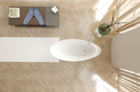 double volume: Overhead view of a modern bathroom interior with a contemporary oval white bathtub, herringbone parquet floor and cabinet with double volume height and tall windows Stock Photo