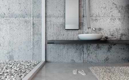 Hand basin in a modern restroom with pebble decor and marble floor and walls with a pair of slip slops