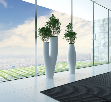 Stylish sculptural plant containers with houseplants standing in front of floor to ceiling glass windows overlooking a patio photo