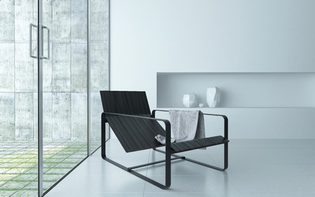Modern comfortable recliner chair on a metal frame in a modern minimalist white living room interior in front of large glass windows and door leading to an outdoor patio photo