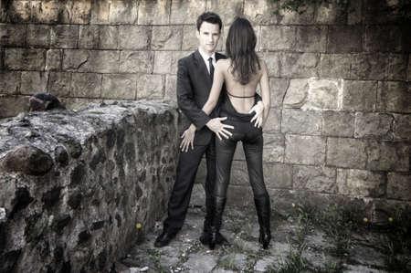 Couple posing at a wall photo