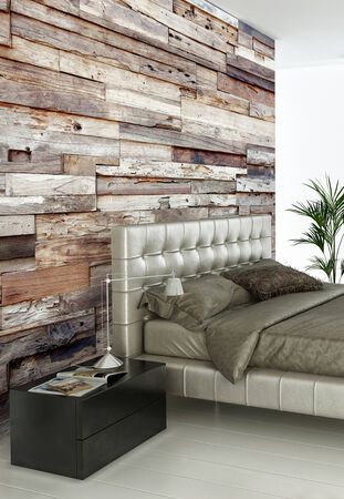 Modern double bed against wooden wall