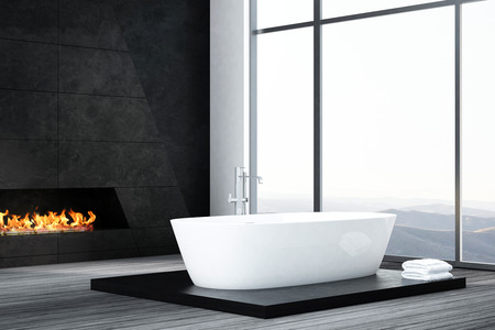bathtub: Dark bathroom interior with bathtub and fireplace Stock Photo